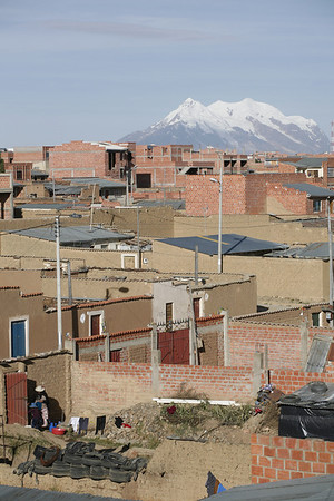 El Alto Scape, 2007 Ever present Illimani is visible from nearly every corner of El Alto, including the northern barrio of Villa Huayna Potosí where Alvaro and his family have lived since the late 1980s. Alvaro's (and Basilia's) father purchased the lot in the 1970s with the idea that the family would use a house there as an urban base, for conducting business when in the city. Since then each of his eight children have lived there at one time or another, and now his grandchildren live there while attending school. In 2011 Alvaro purchased the home from his father after his siblings moved to a peripheral barrio called Urbanizacion Bautista Saavedra, along the road to Tiwanaku, Guaqui and Desaguadero.